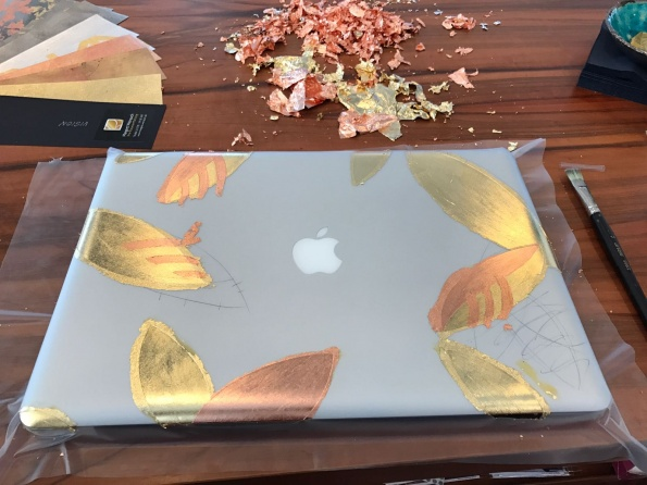 Laptop mit Gold